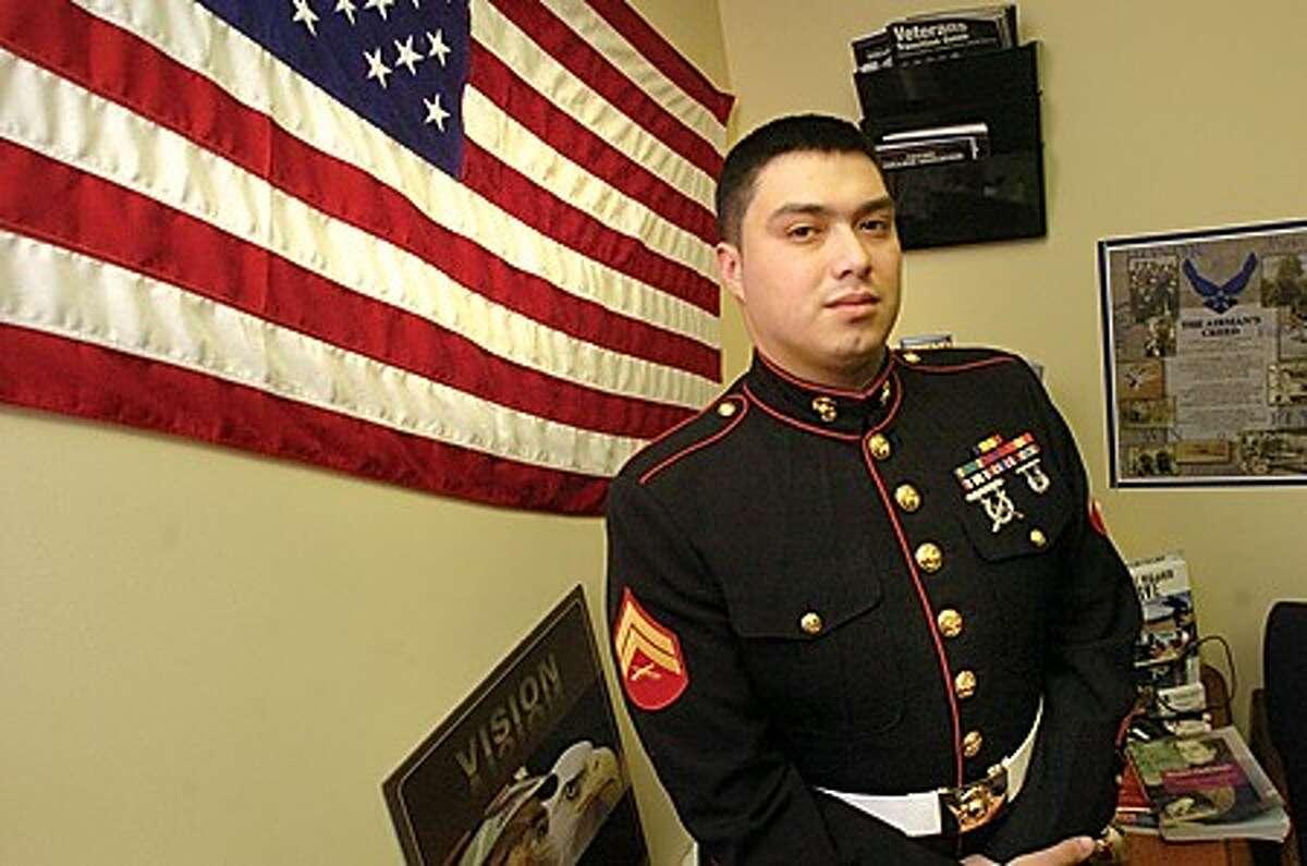 Alejandro Rojas an Iraq war veteran and president of the Norwalk Community College veterans club at the school on Thursday. hour photo/matthew vinci