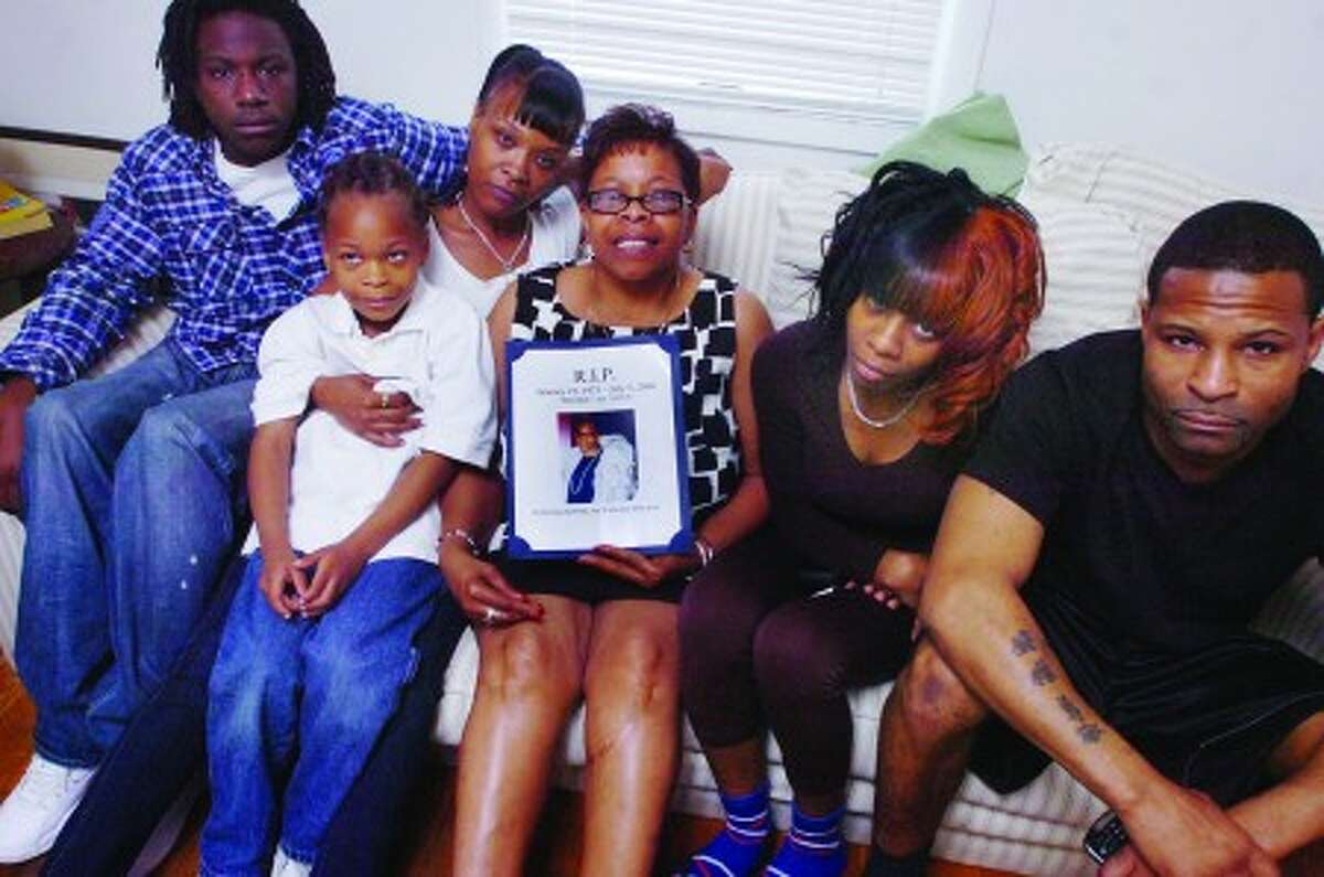 Yvonne Moore the mother of LaRay Moore who murdered at Roodner Court in June 2006 holds his photo. From left is George Moore brother of LaRay, Natacha Moore LaRay''s wife and her son LaRay jr 5. On the right is 19 year old Breyona Samson and other brother Shakha Moore. hour photo/matthew vinci