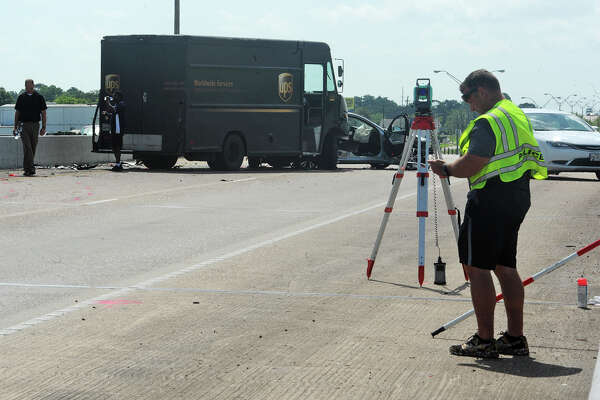 Beaumont Police investigate a wreck that killed a driver on Cardinal Drive near Erie Street Friday morning. A UPS truck and another vehicle were involved in the accident.  Photo taken Friday, June 17, 2016 Guiseppe Barranco/The Enterprise