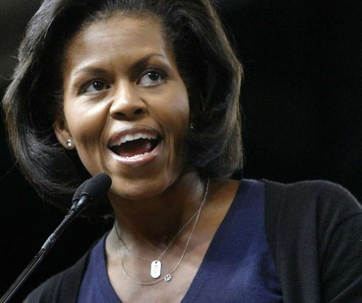 In this Oct. 13, 2008, file photo, Michelle Obama, wife of President Barack Obama, speaks to supporters during a rally at Macalester College in St. Paul, Minn.