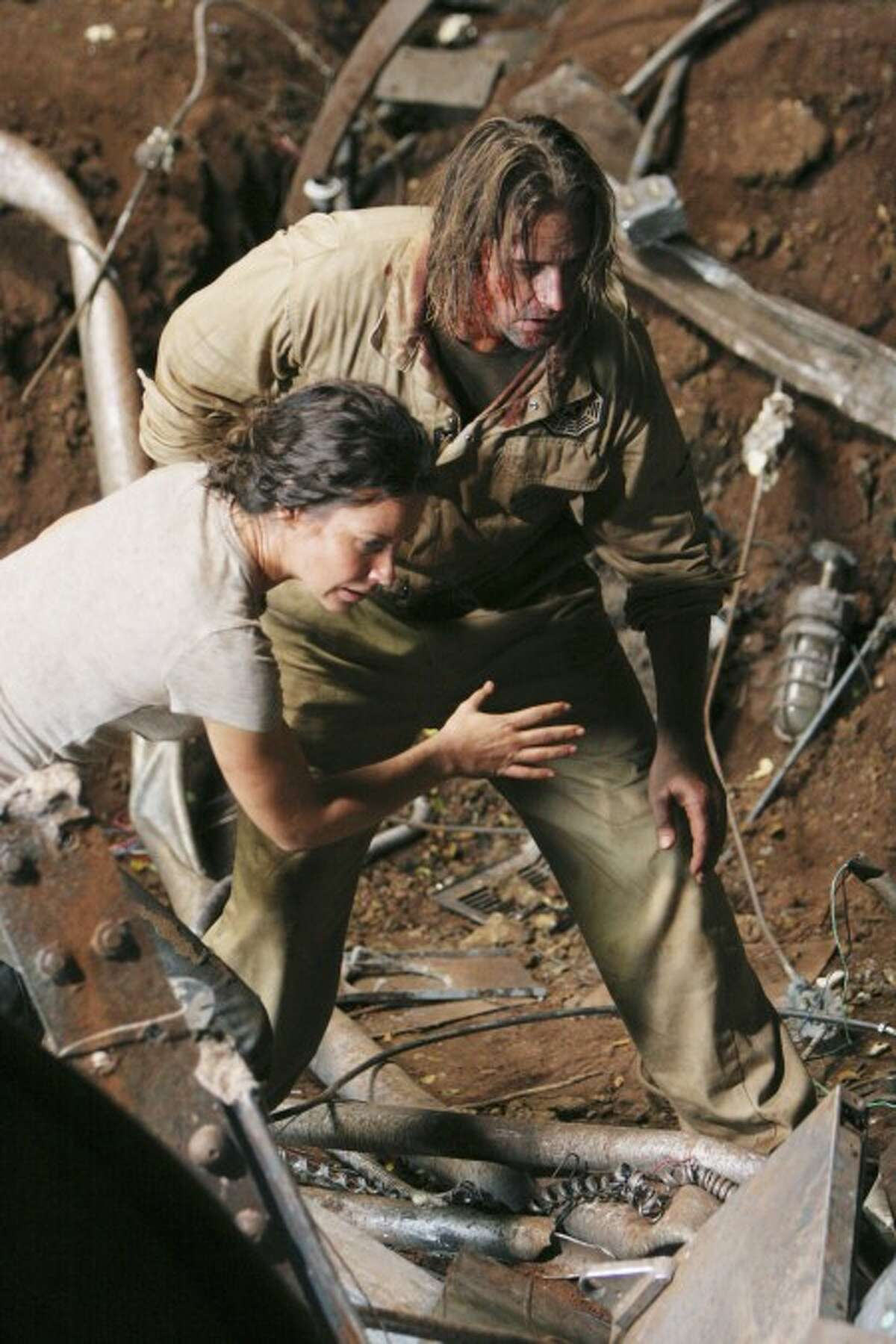 """Evangeline Lilly,left, and Josh Holloway a scene from """"Lost"""" which returns for its final season. (AP Photo/ABC,Mario Perez)"""