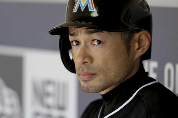 Miami Marlins' Ichiro Suzuki looks on from the dugout in a baseball game against the San Diego Padres Wednesday, June 15, 2016, in San Diego. (AP Photo/Gregory Bull)