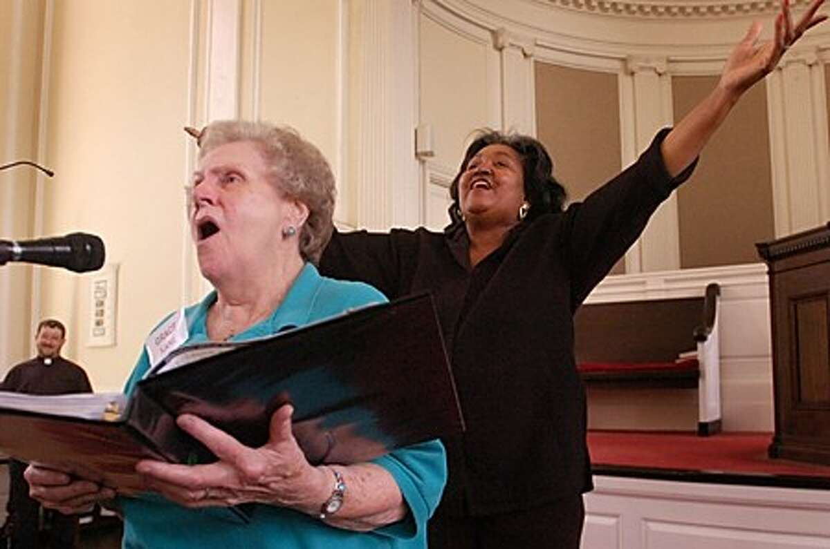 """Seredipity Chorale soloist Grace Kane and chorale director GiGi Van Dyke lead the audience in the Opening Hym, """"How Great Art Thou"""", during the Serendipity Chorale''s 35th anniversay program """"This Little Heart of Mine"""" at the First Congregational Church Saturday. Hour photo / Erik Trautmann"""