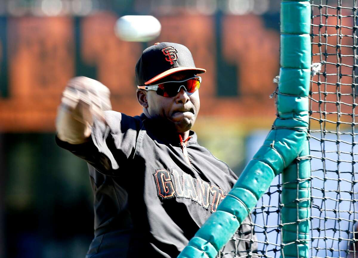 Giants' bench coach, Hensley Meulens throws during batting practice, as the San Francisco Giants prepare to take on the Oakland Athletics in a spring training game at Scottsdale Stadium, in Scottsdale, Arizona on Wednesday Feb. 26, 2014.