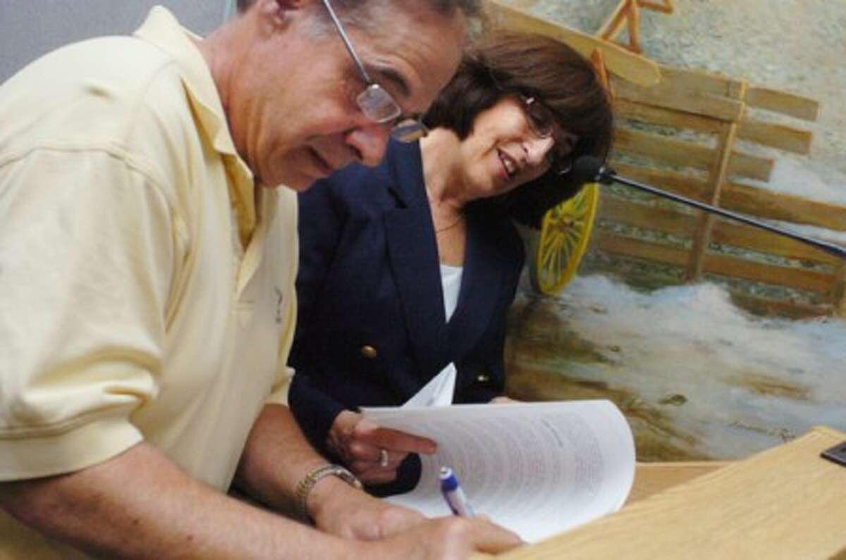 Hour File Photo - Former Norwalk Board of Education Chairman Glenn Iannaccone. with the Superintendent of School Susan Marks.