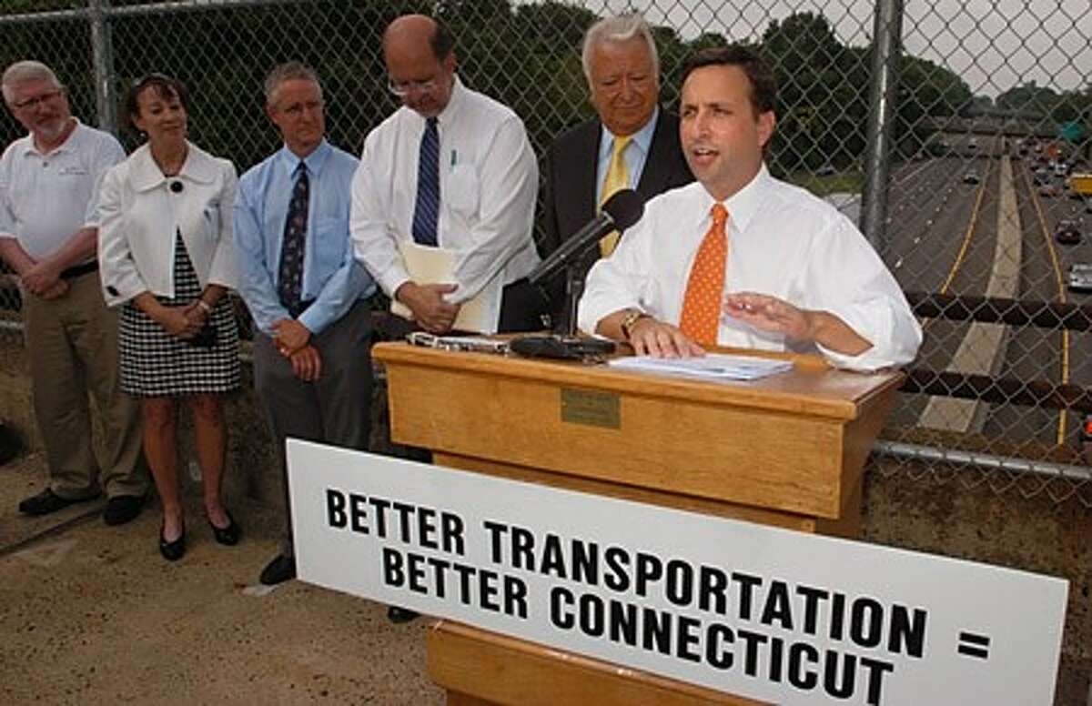 State Senator Bob Duff assembled state and local officials to announce the release of the new report by TRIP, a national transportation research group, which evaluated conditions and funding need of Connecticut ''s roads, bridges and transit system during a press conference in Norwalk Thursday. Hour photo / Erik Trautmann