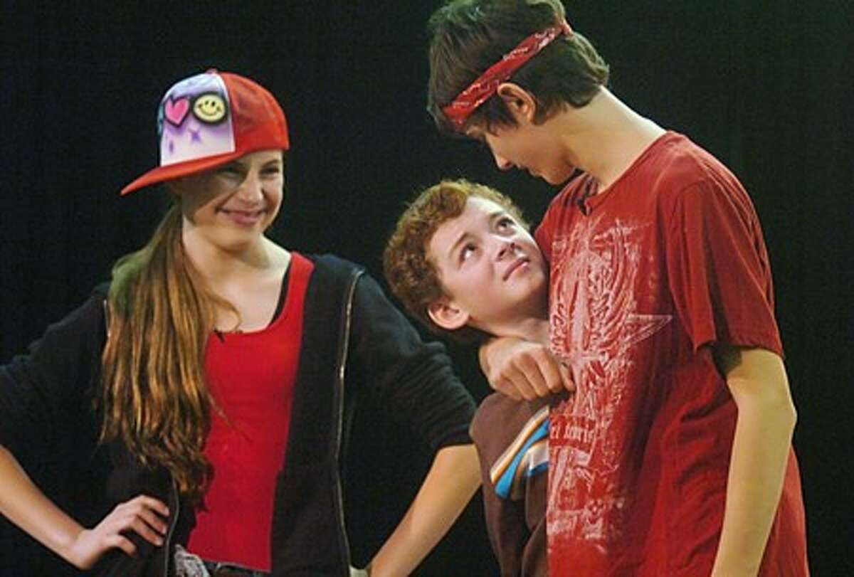 """Actors with the Random Farms Kid''s theater, Charlotte Cooper, Benjamin-Milan Polisar and Evan Rocco perform in """"The New Kid"""", a play addressing the problems of bullying, for students at Rowayton Elementary School Friday morning. Hour photo / Erik Trautmann"""