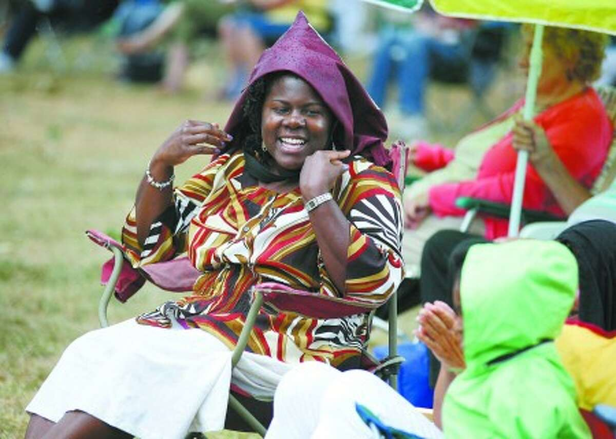 Lisa Armstrong enjoys a performance by Deja Vu on the Norwalk Town Green Sunday afternoon. Hour Photo / Danielle Robinson