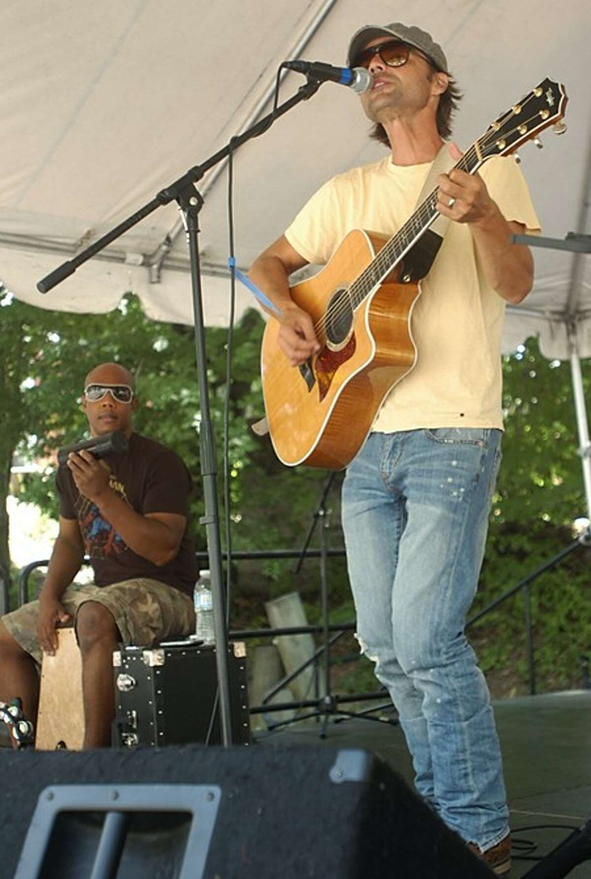 Damon Grant plays with P.J. Pacifico at the Songwriters Stage at the Sono Arts Festival Saturday. Hour photo / Erik Trautmann