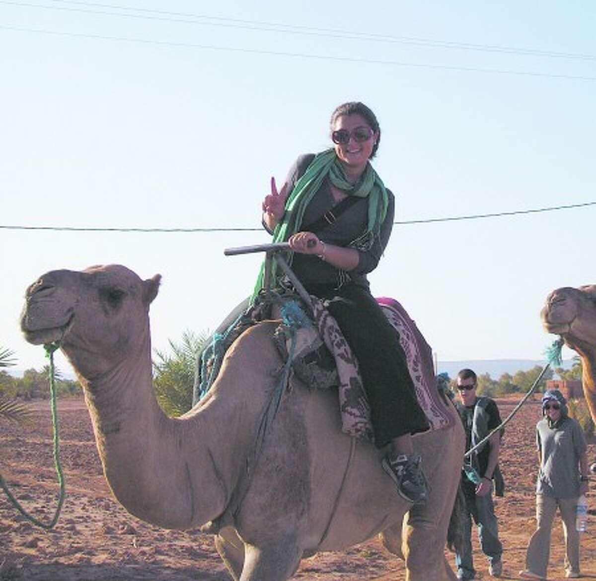 Sonya Jeffereis, a 2006 Wilton High School graduate, traverses the Sahara Desert in Morraco on camel back. Contributed photo