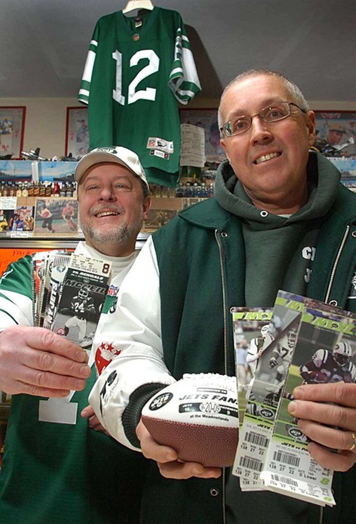 Jim and Bob Macedo of New Canaan Ave Liquor are the consummate Jets fans. Hour photo / Erik Trautmann