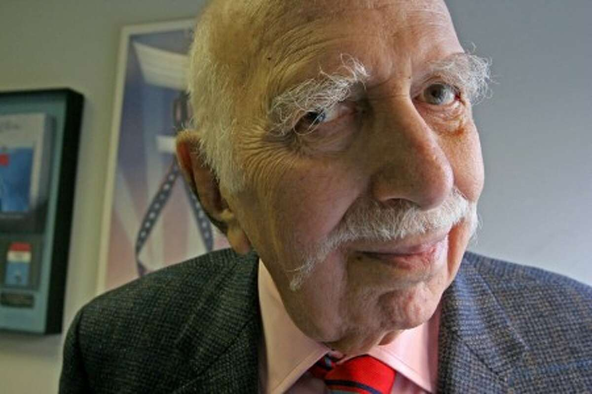FILE - In this Sept. 18, 2006 file photo, David Brown poses for a photograph in his office in New York. Brown, a film and theater producer, died Monday, Feb. 1, 2010 at his Manhattan home. He was 93. (AP Photo/Tina Fineberg, File)
