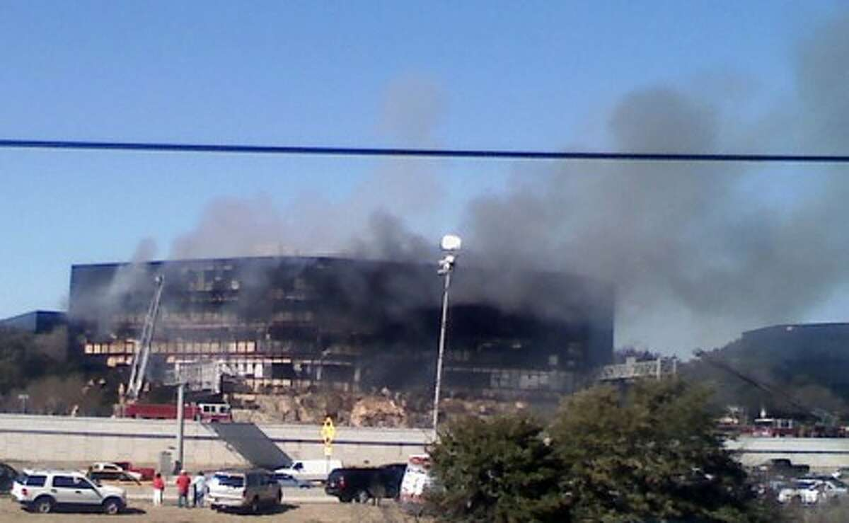 Smoke billows from a seven-story building after a small private plane crashed into the building in Austin, Texas on Thursday Feb. 18, 2010. (AP Photo/Austin American-Statesman, Claudia Grisales) MANDATORY CREDIT. NO MAGS, NO SALES, NO TV