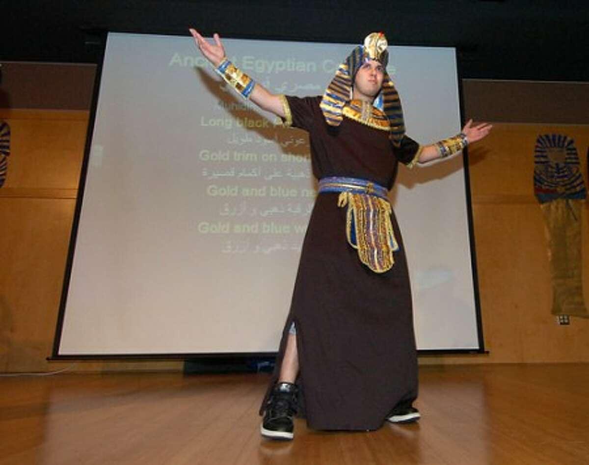 Photo/Alex von Kleydorff. Brien McMahon Senior Julian Velez takes part in a fashion show wearing Ancient Egyptian Pharoh dress during an Araboc fair at The Center for Global Studies