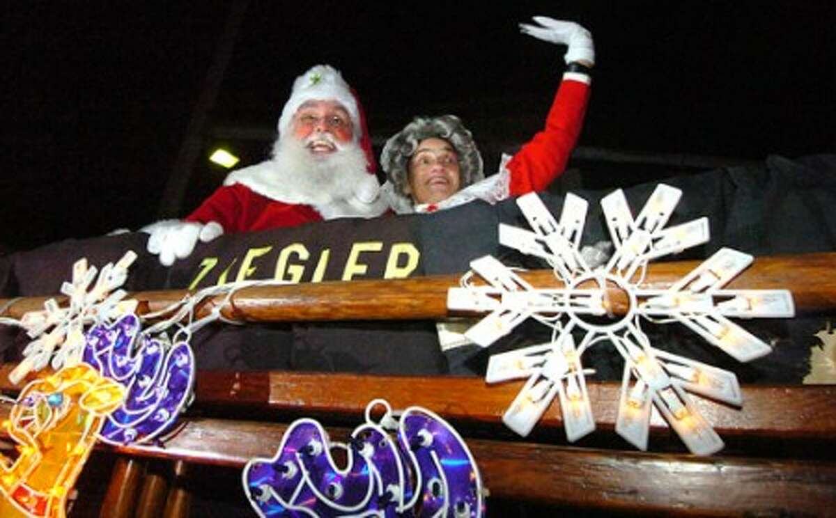 Photo/Alex von Kleydorff. Santa and Mrs. Clause wave to the crowd during Stamfords Heights and Lights Sunday night.