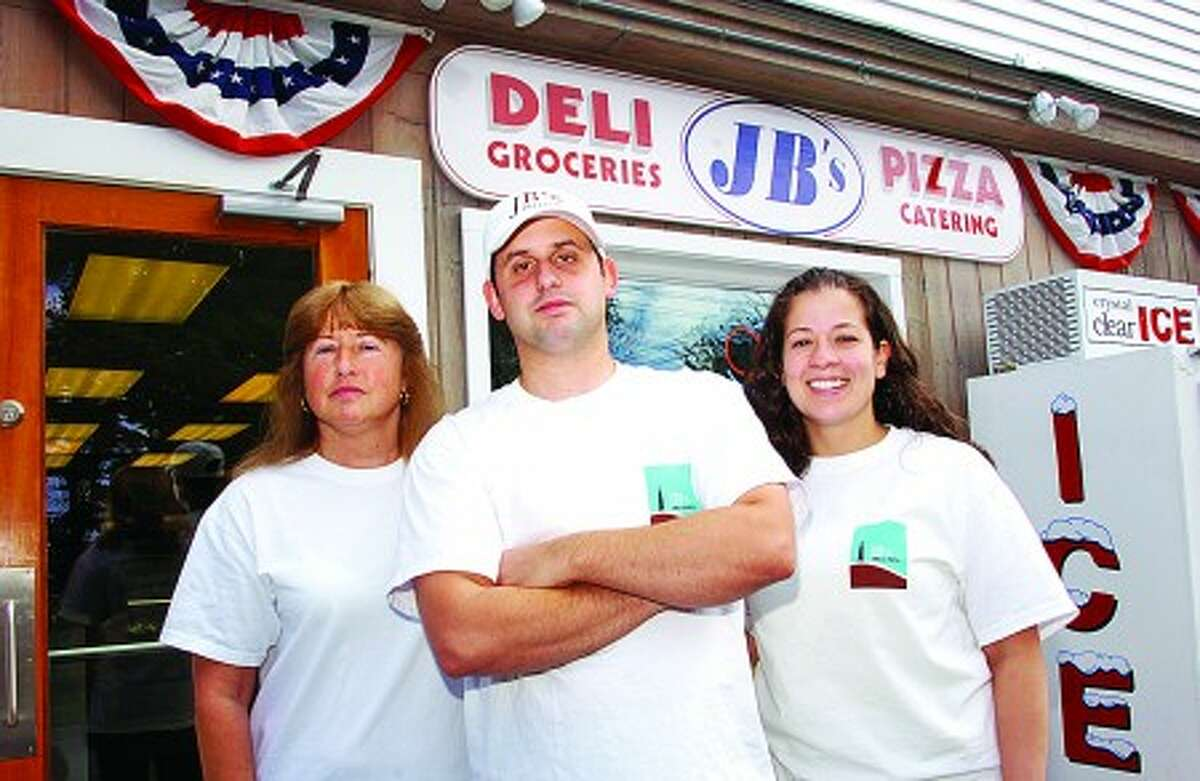 John Burr and his mother Mary Burr and wife Adrienne at their new new deli on Tierney St in Norwalk. Hour photo / Erik Trautmann