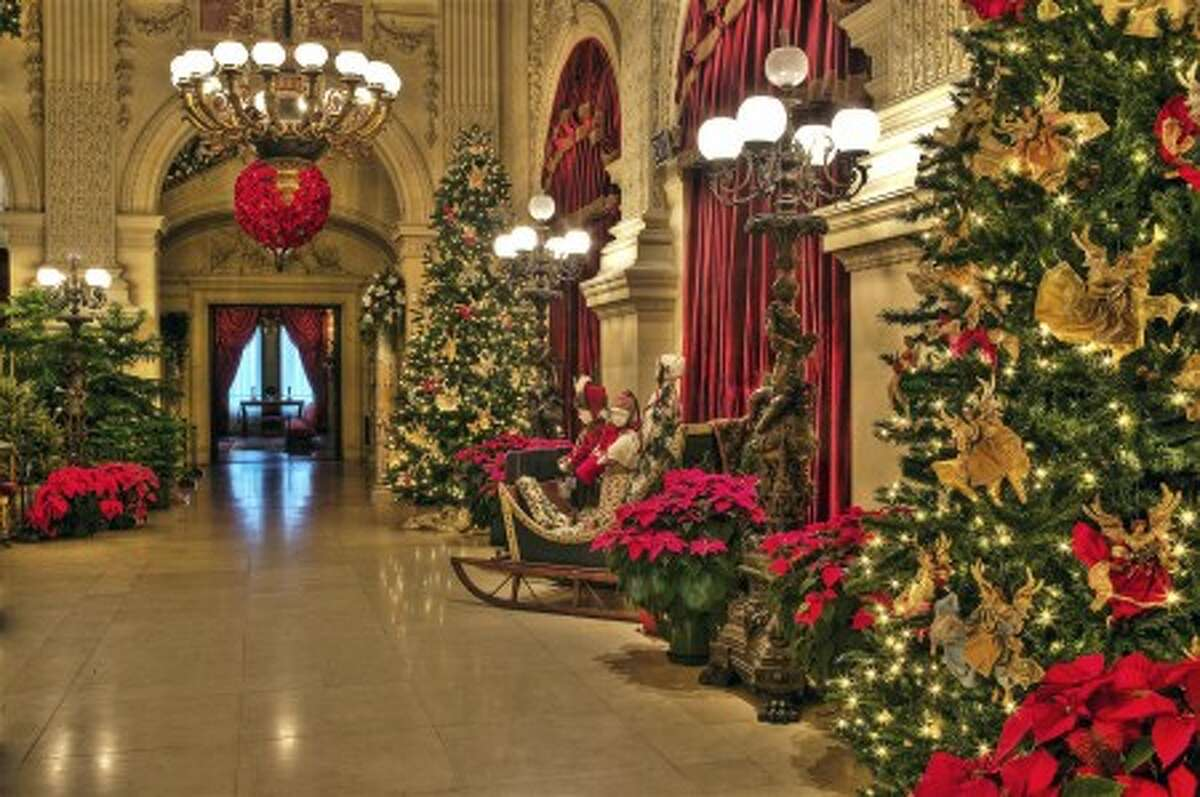 This undated photo courtesy of The Preservation Society of Newport County/Ira Kerns shows the Great Hall at The Breakers decorated for Christmas in Newport, R.I. During the winter months, Newport''s famous mansions are decorated for the holidays and host concerts and performances. (AP Photo/The Preservation Society of Newport County, Ira Kerns) NO SALES