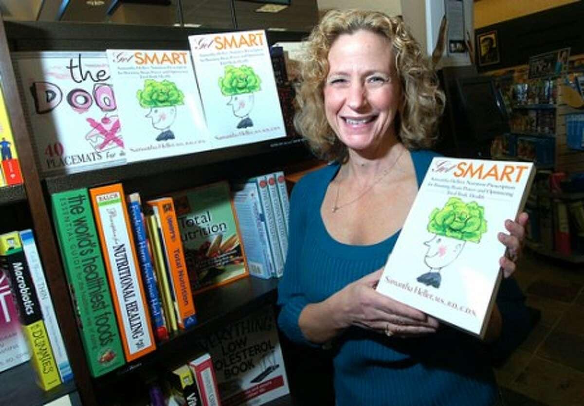 Photo/Alex von Kleydorff. Author Samantha Heller and her latest book Get Smart.