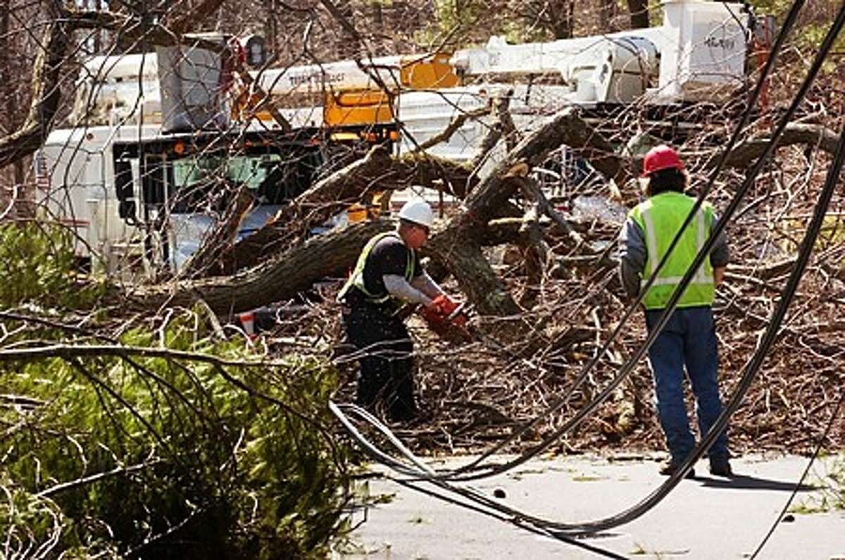 CL&P workers cut downed trees on Marion Rd in Westport Tuesday. Hour photo / Erik Trautmann