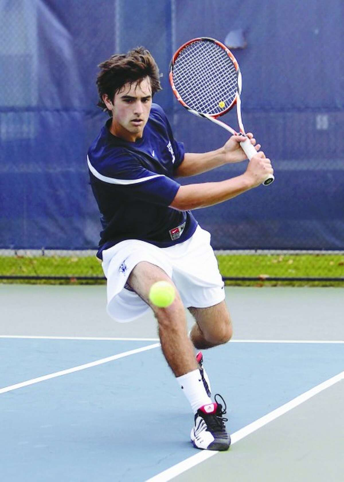 Former Greens Farms Academy and Yale men''s tennis player Marc Powers goes to the backhand in a recent match. Powers is having a fine first season as a member of the Bulldogs. Contributed photo