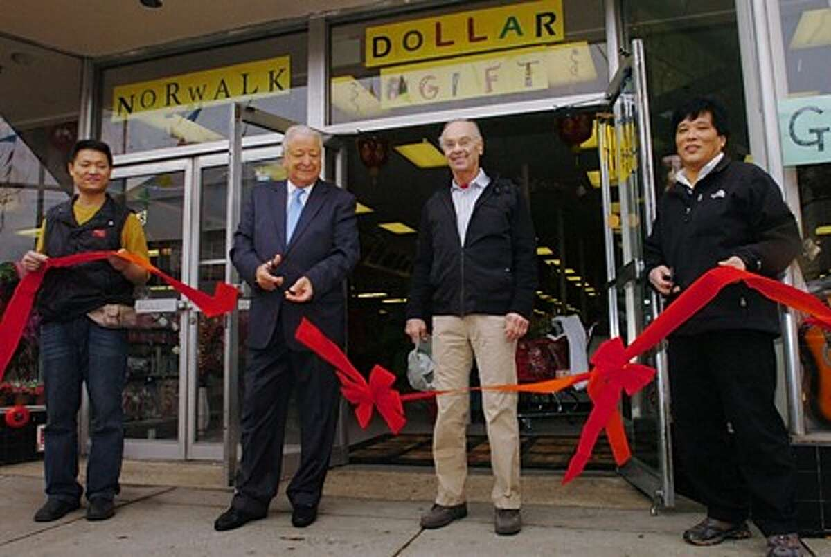 Wei Chan, Mayor Richard Moccia, building owner Hal Fischel and Mike Fu hold a ribbon cutting ceremony in front of the new Norwalk Dollar and Gift store at 68 Wall St. Tuesday. Hour photo / Erik Trautmann