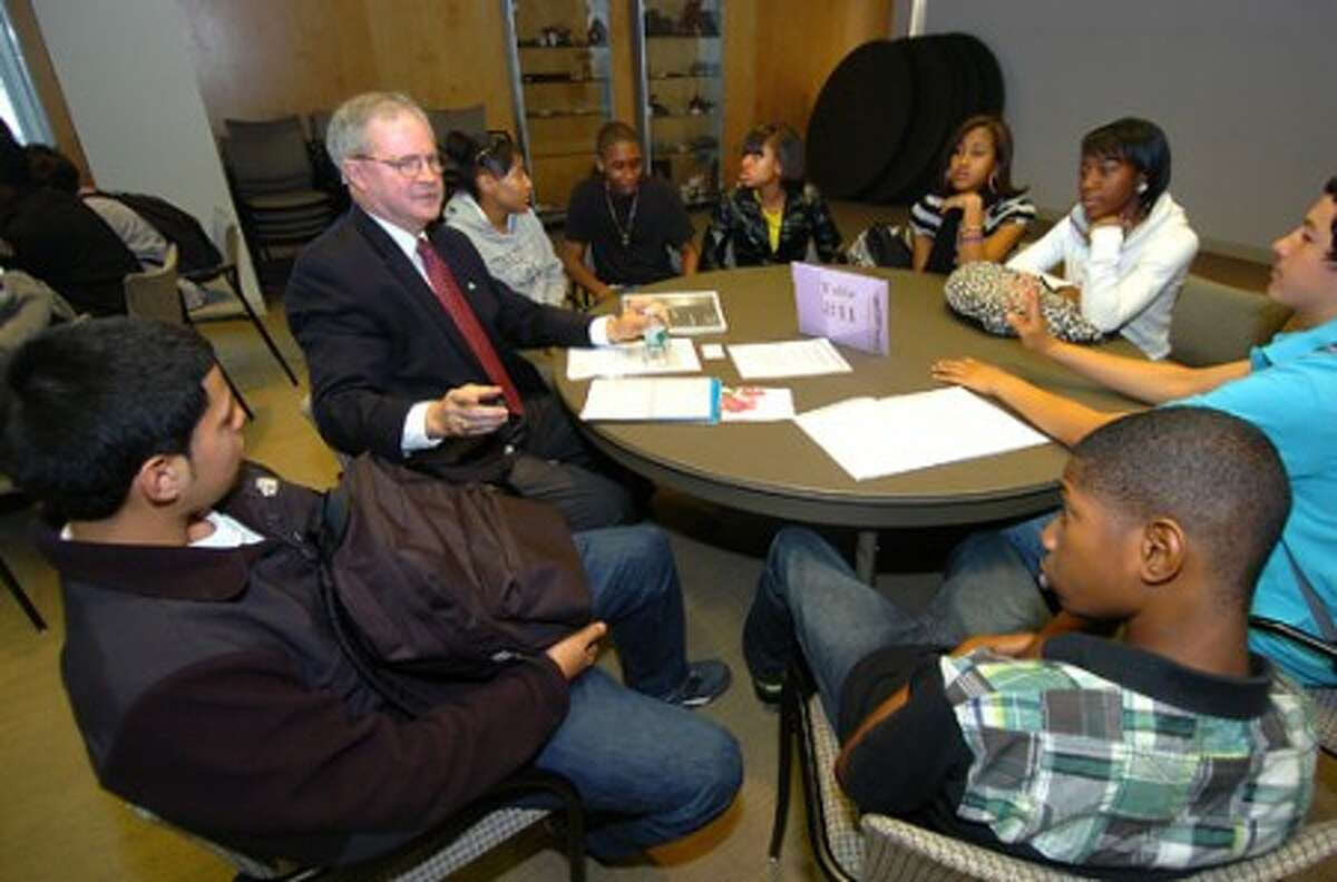 Photo/Alex von Kleydorff. David Van Buskirk Vice President of The Bank of New Canaan, speaks to a group of Brien McMahon students during the School to Career program.