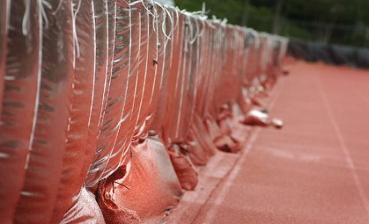Photo/Alex von kleydorff. The fence around Testa Field is sheilded by plastic from overspray of the red rubberized material that is being used to re surface the track.