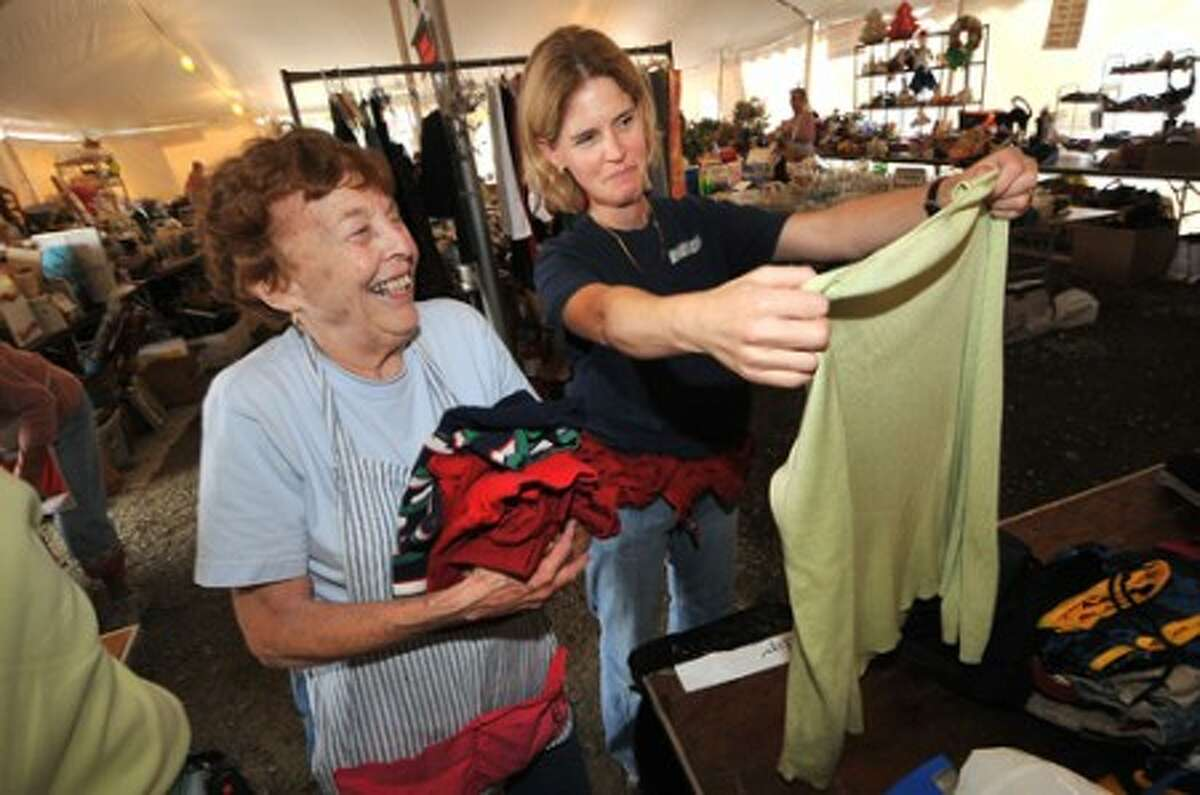 Photo/Alex von Kleydorff. L-R Mary Lou Logan and Julie Sweeney sort through ladies clothing for this weekends Minks to Sinks in Wilton.