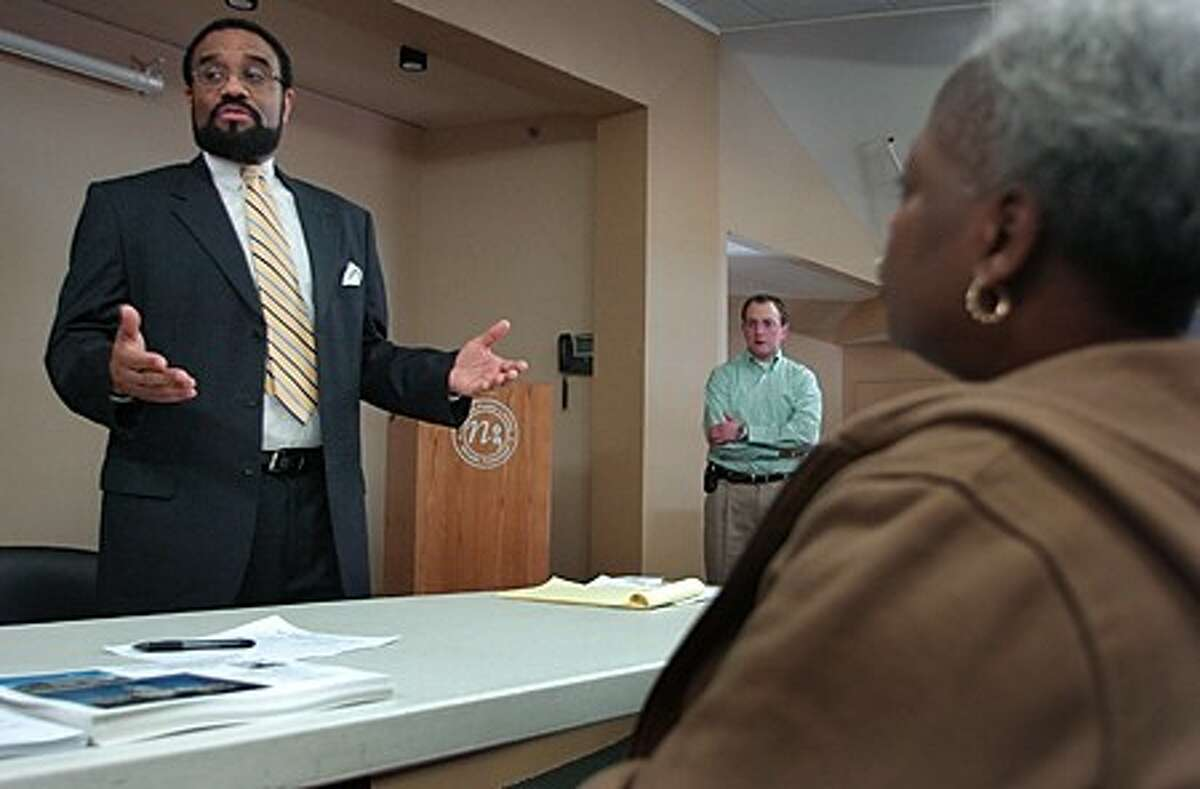 State Rep. Bruce Morris, D-140, meets with his constituents in the community room at the South Norwalk Library Saturday and take their questions. Hour photo / Erik Trautmann