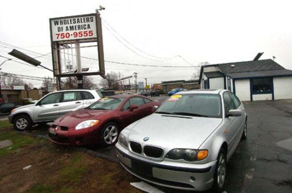 Photo/Alex von Kleydorff. Wholesalers of America used car lot on Main Ave.