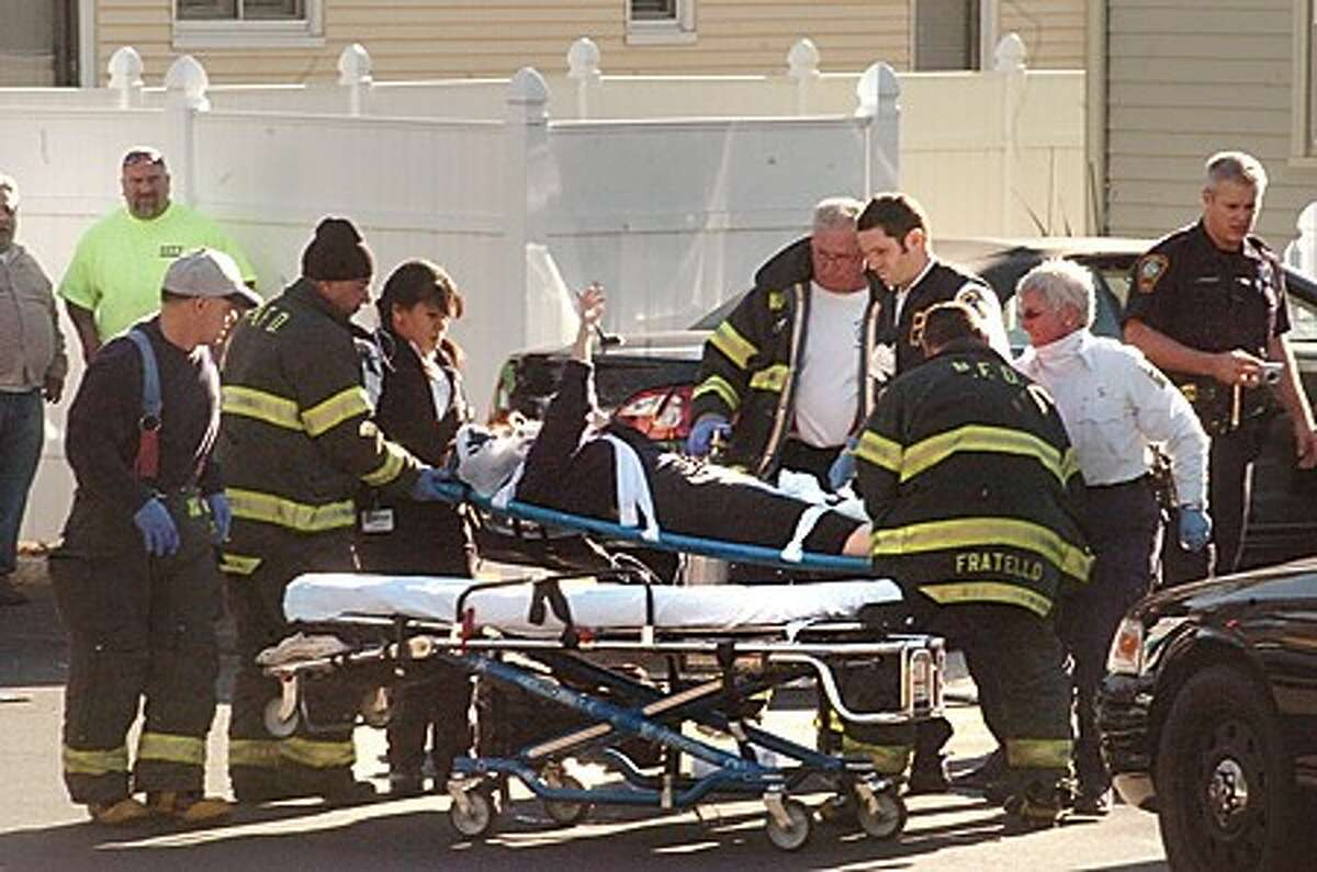 Police and fire departments respond to a pedestrian hit by a car on George Street in Norwalk at around 2:00 Thursday. hour photo/matthew vinci