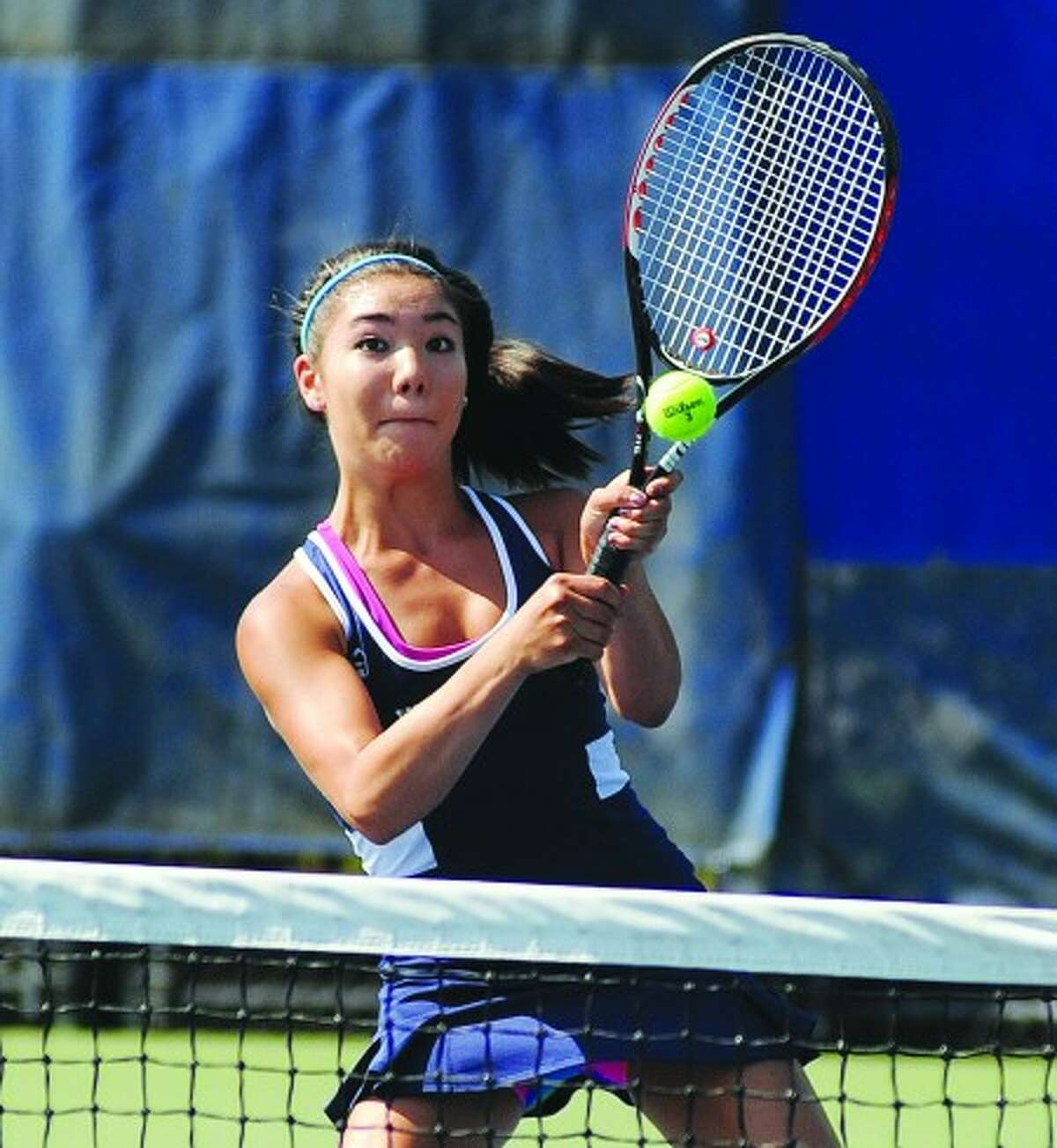 Wilton girls tennis player Amanda Sakamato gets ready for a quick volley return during her first doubles match against New Canaan on Friday. Hour photo/John Nash