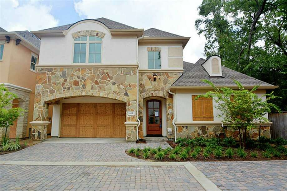 The French country-style architecture, with stone and stucco exteriors, gives a warm atmosphere to the community.