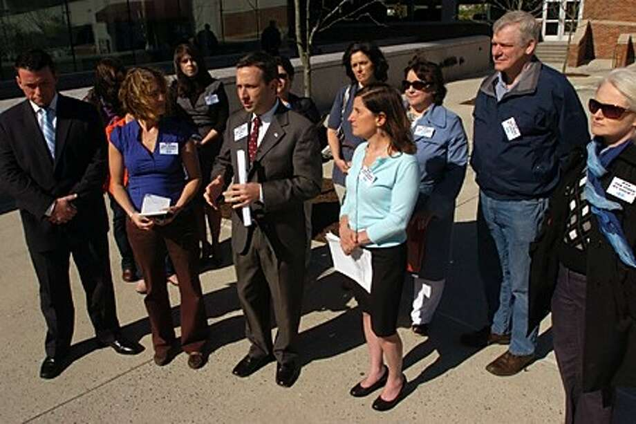 State Senator Bob Duff, center, participates in a press conference with parents of autistic children outside Stamford Superior Court where Stacy Lore entered her plea Wednesday morning. Lore, the former executive director of the now defunct Spectrum, LLC, fraudulently claimed to hold certification before signing a contract with Norwalk Public Schools in 2007 when she provided support for autistic students. Hour photo / Erik Trautmann