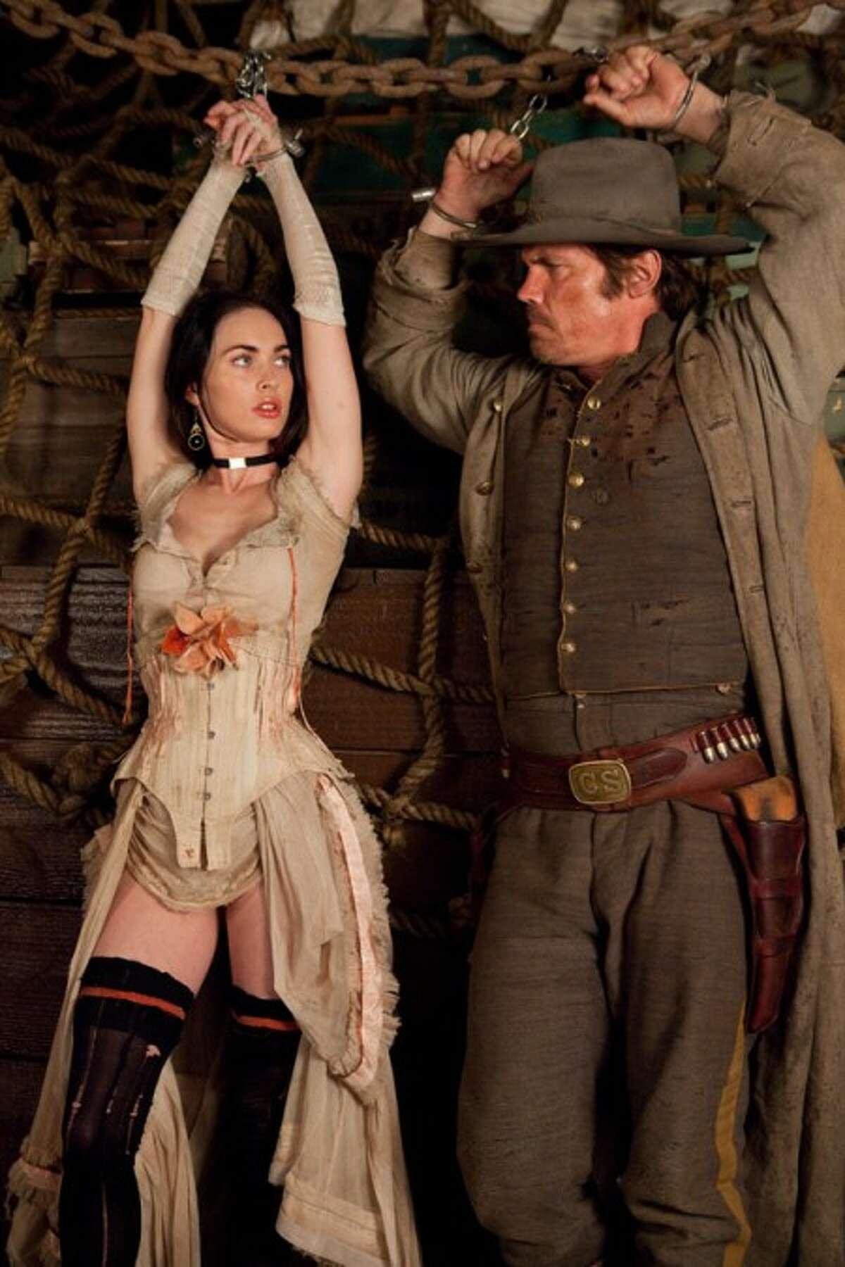 "In this film publicity image released by Warner Bros., Megan Fox, left, and Josh Brolin are shown in a scene from, ""Jonah Hex."" (AP Photo/Warner Bros., Jamie Trueblood)"