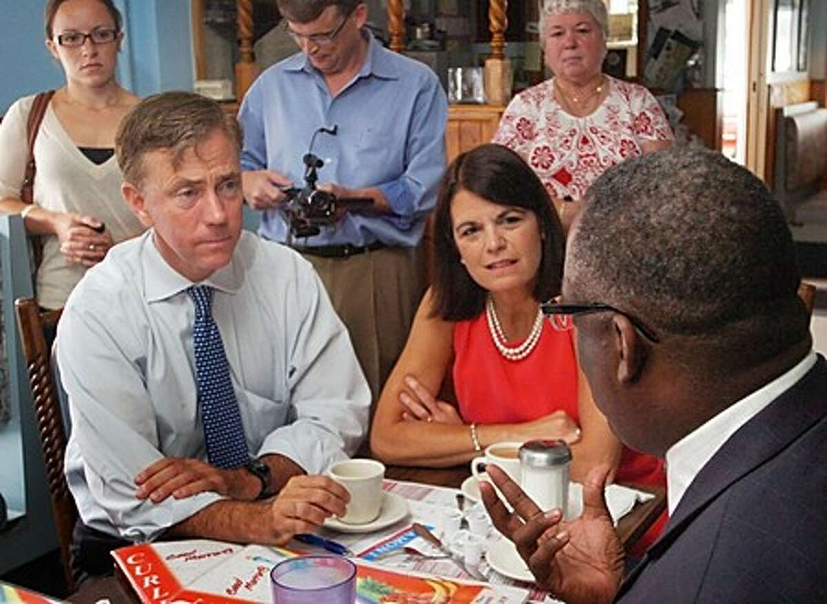 Gubernatorial candidate Ned Lamont, center, listens to local community leaders including the Reverend Tommy Jackson talk about affordable housing, education and jobs during a Stamford Jobs Round Table discussion at Curly''s Diner Thursday morning. Hour photo / Erik Trautmann