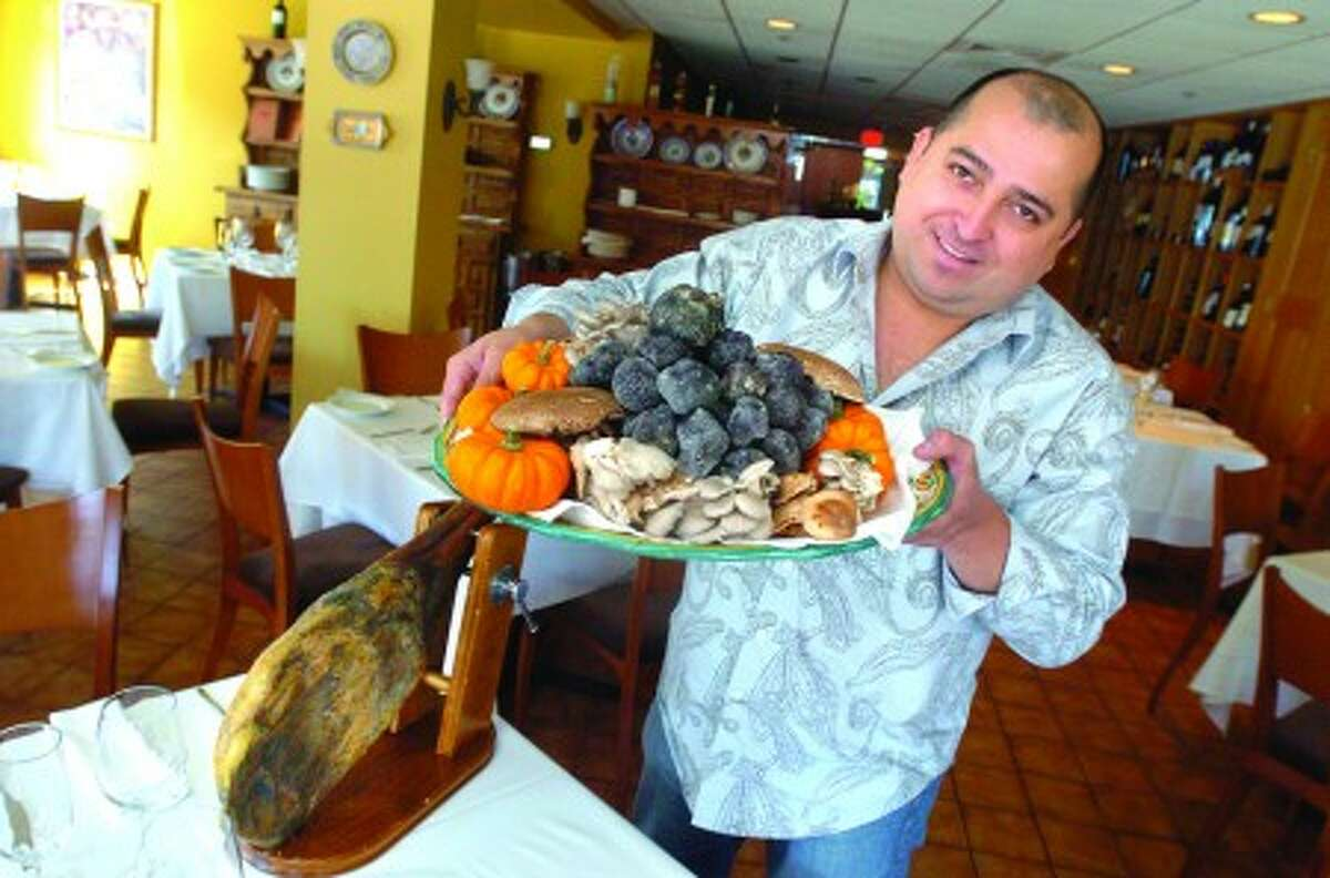 Carlos Hernandez, owner of Meigas restaurant in Norwalk with a tray of black truffles that will be the highlight of a dinner served at the restaurant Friday September 24th and will also feature high end wines. hour photo/matthew vinci