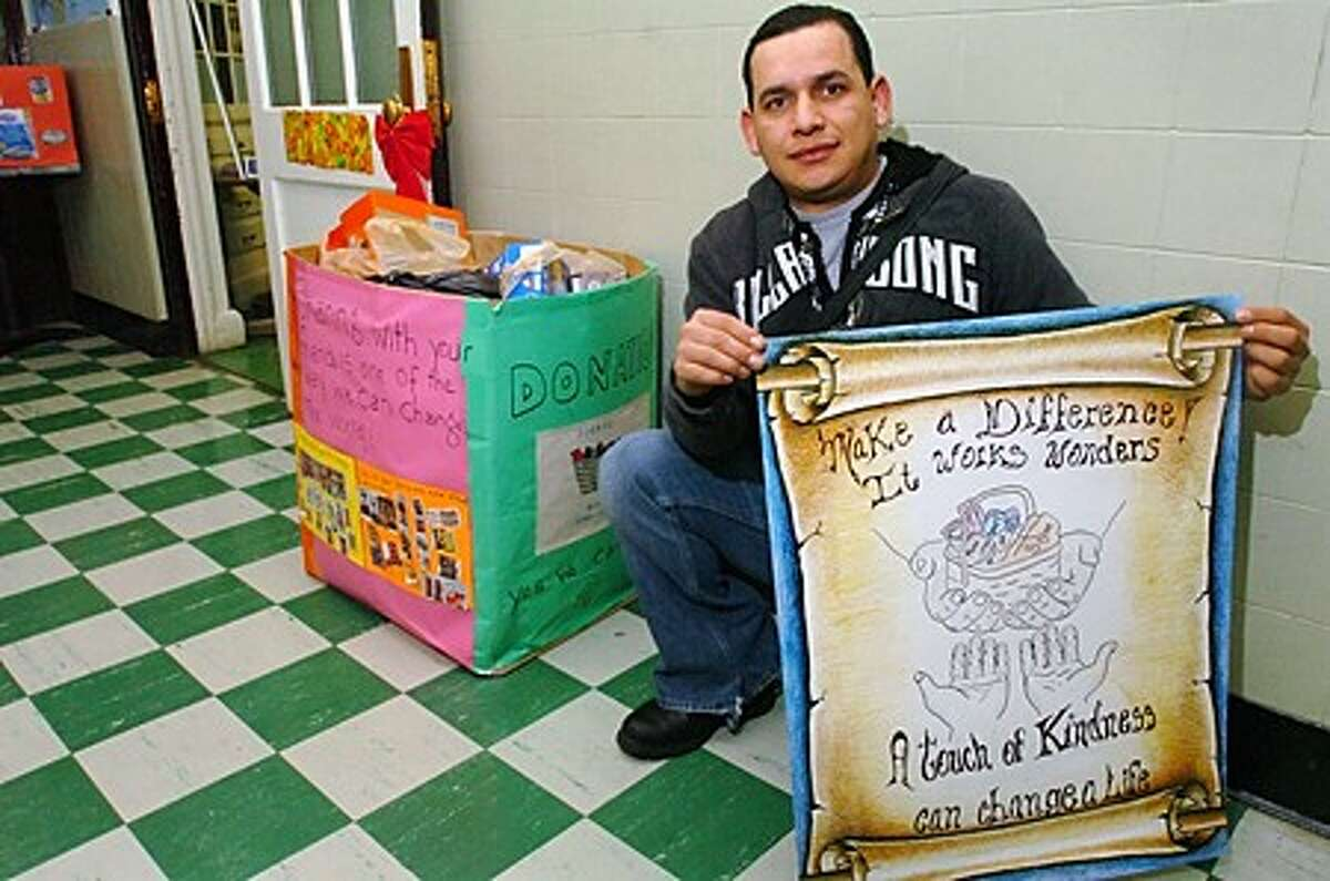 Adult Learning Center English as a Second Language (ESL) student Kimber Herrera, designed a poster for the class''s food drive for the Fairfield County Food Bank in Stamford. Hour photo / Erik Trautmann