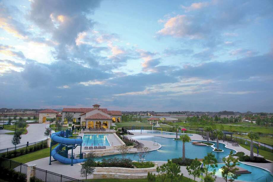 The Club at Aliana, a resort-style activities center, is for residents only and includes a 24-hour fitness facility, five-pool swim center, tennis court, large party rooms and a ballroom for special events. Photo: Terry Vine Photography