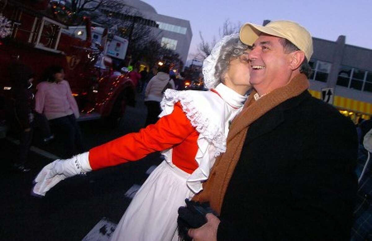 Photo/Alex von Kleydorff. Stamford Mayor Mike Pavia gets a kiss from Mrs. Clause