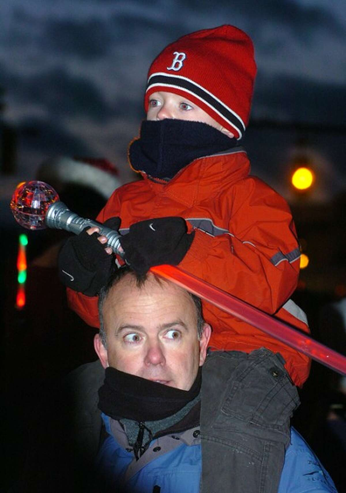 Photo/Alex von Kleydorff. 5yr old Colin Bauer on his father Gary''s shoulders for a better look at Santa.