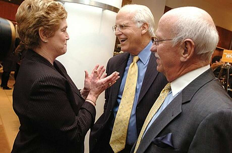 """Connecticut Governor M. Jodi Rell and Sound Waters Executive Director Len Miller greet former Congressman Chris Shays at Scott Mitchell & Richards of Greenwich for the Soundwaters sponsored """"Friendly Roast """" of Shays on Wednesday night. hour photo/matthew vinci"""