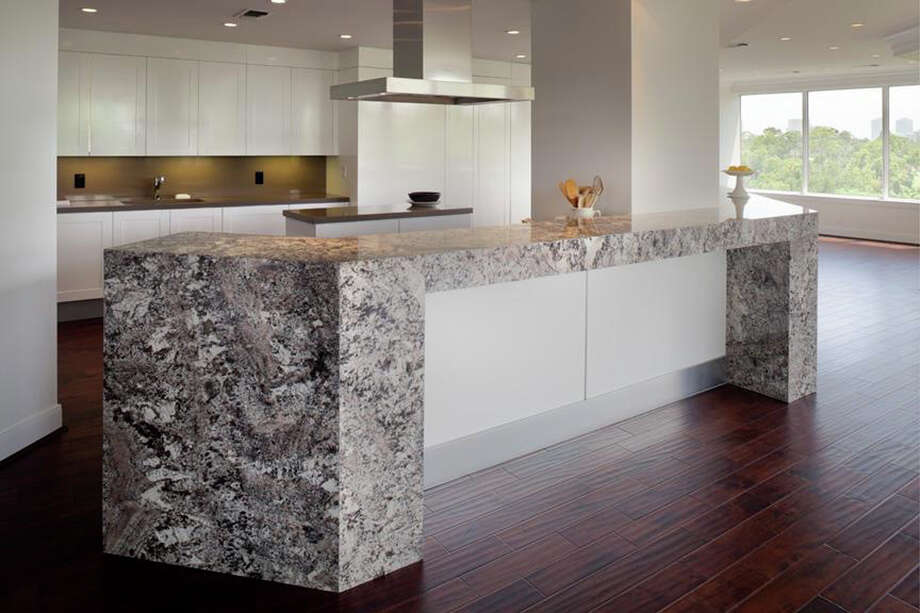 The kitchen features white Torroncino granite and Silestone Unsui solid surface by Consentino. Photo: Courtesy Of PavlinaStone Inc.