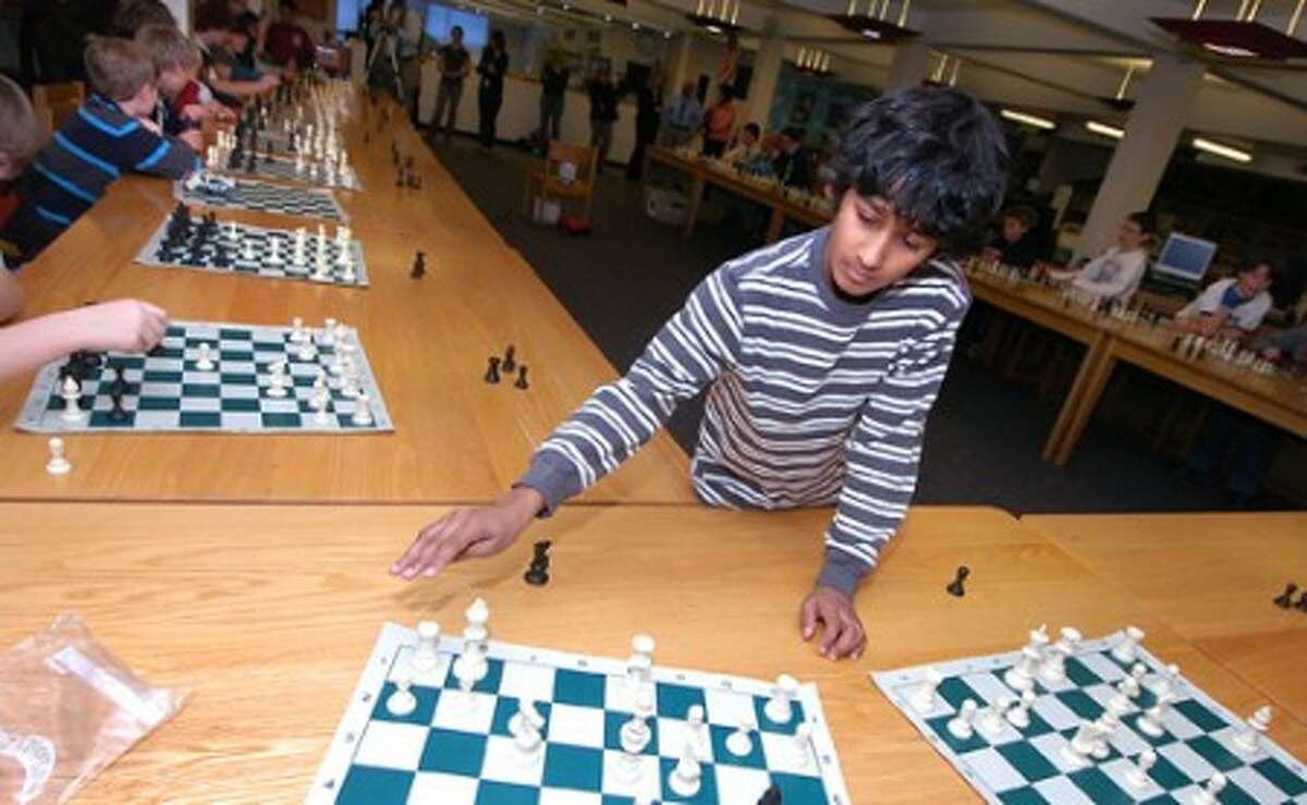 """Photo/Alex von Kleydorff. 11yr old Middlebrook School 6th Grader kapil Chandran makes a move as he plays 38 opponents at the same time during """"Let''s Make a Move for Haiti"""" Fundraiser."""