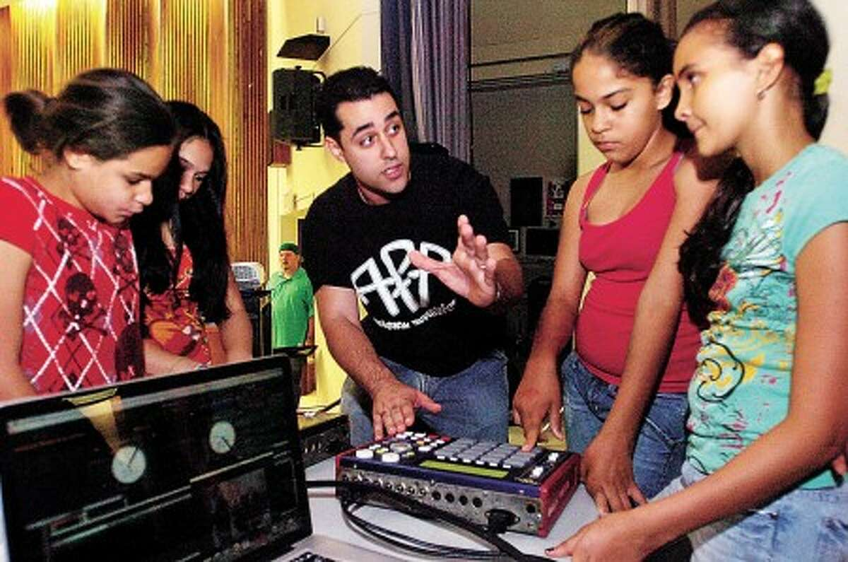 Dariel Benitez, aka Definition, teaches a beat box production workshop to Mriam Reyes, Wenday Gonzalez, Jessica Esquibel and Shayla Hernandez during the 4th Annual Hip Hop Summit at Westhill High School Saturday. The Summit is being coordinated by the Connecticut-based hip hop artist collective Ant Farm Affiliates in conjunction with the Stamford Public Schools. Hour photo / Erik Trautmann