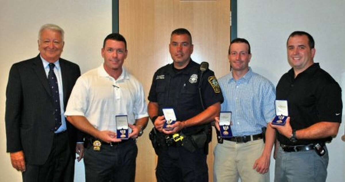 Officers who captured suspect in double homicide honored