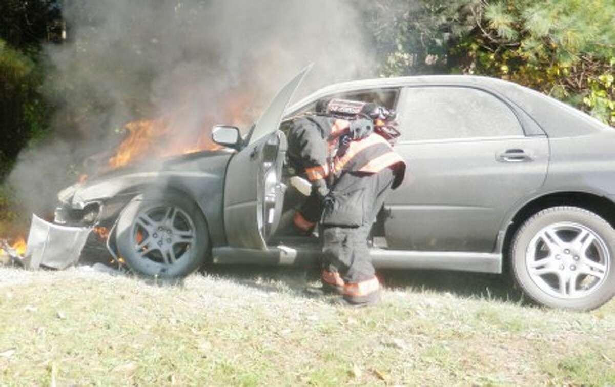 Westport fire crews extinguish a car fire Sunday morning.