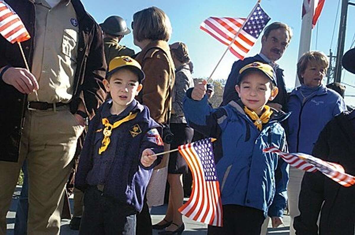 Alexander Grant Cameron and Jacob Nelson both 7 with the Cub Scouts Den 12 Pack 17 celebrate Veterans Day Thursday at the dedication of the Veterans Memorial Green in Wilton. hour photo/matthew vinci