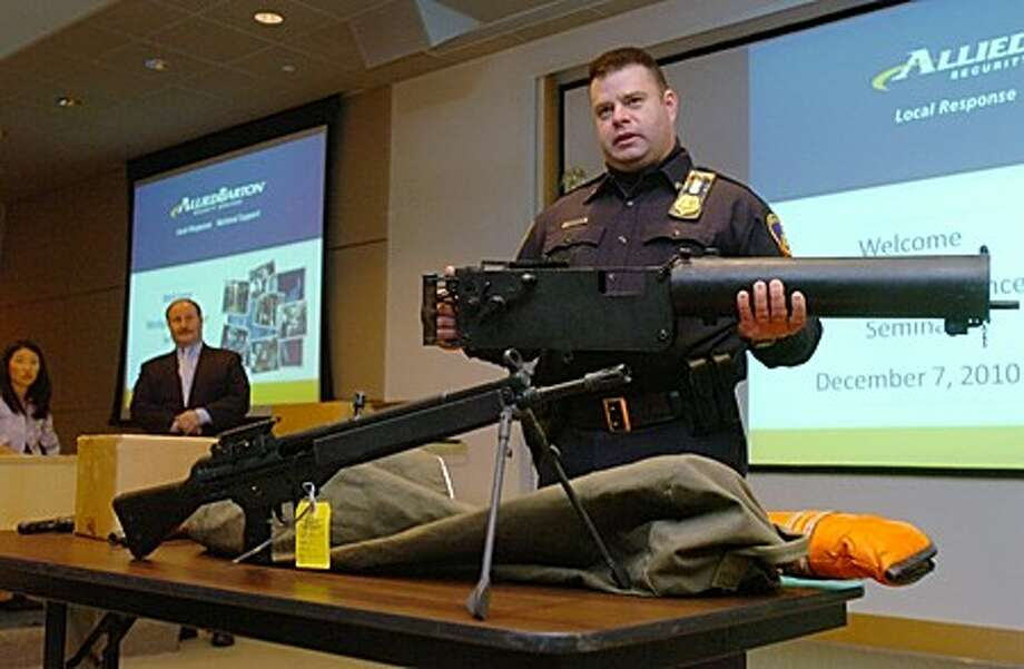 Sgt. Kevin Fitzgibbons of the Stamford Police Department and Downtown Special Services speaks on workplace violence and active shooter prevention while he displays confiscated weapons during a seminar by AlliedBarton Security Services at Purdue Pharma in Stamford Tuesday morning. Hour photo / Erik Trautmann