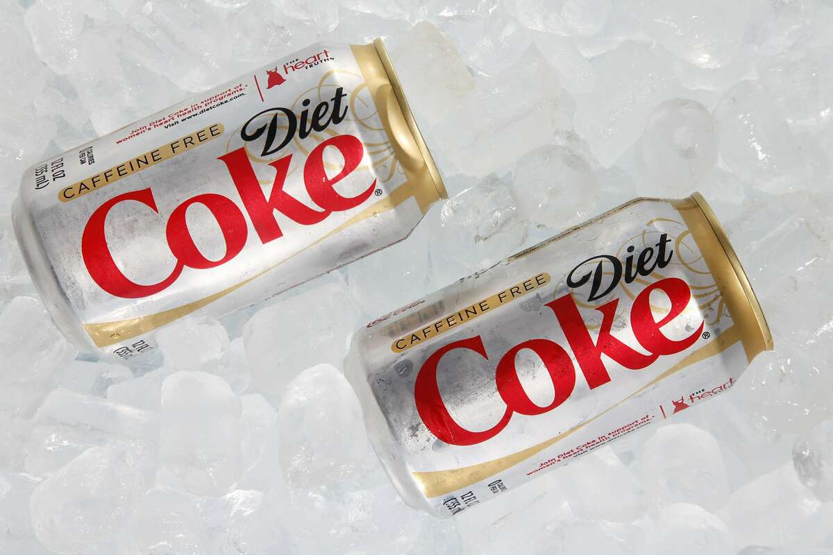 FILE - This Monday, Oct. 15, 2012 file photo shows two cans of Caffeine Free Diet Coke on ice in Surfside, Fla. During a conference call with analysts Tuesday, Oct. 15, 2013, a Coca-Cola executive noted that Diet Coke was